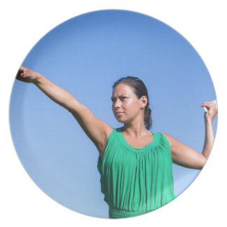 Dutch woman throwing boomerang in blue sky plate