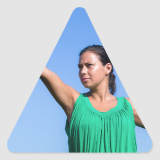 Dutch woman throwing boomerang in blue sky triangle sticker