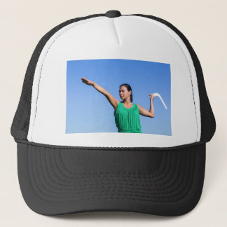 Dutch woman throwing boomerang in blue sky trucker hat