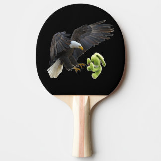 Eagle scares to a teddy ping pong paddle