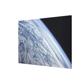 Earth's horizon against the blackness of space stretched canvas prints