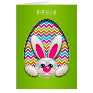 easter bunny hiding in egg over chevron background card