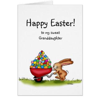 Easter Bunny moves colored eggs in wheelbarrow Card