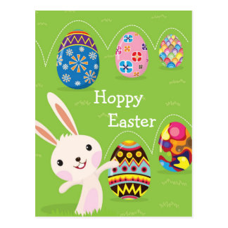 Easter bunny playful with painted eggs postcard