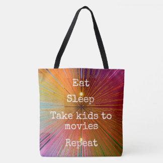 """Eat. Sleep. Kids to Movies. Repeat."" quote orange Tote Bag"