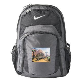 Edaphosaurus dinosaur walking in the desert backpack
