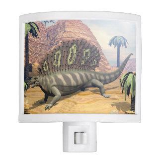 Edaphosaurus dinosaur walking in the desert night light