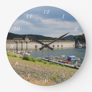 Edersee concrete dam with low water large clock