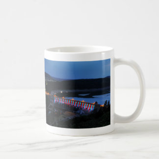 Edersee lit up concrete dam in the evening coffee mug