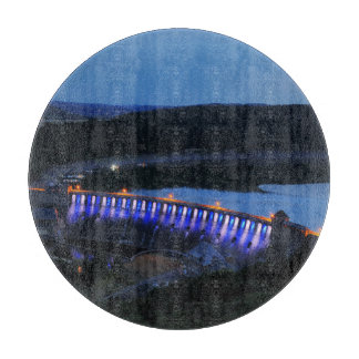 Edersee lit up concrete dam in the evening cutting board