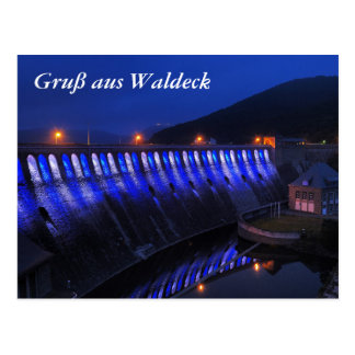 Edersee lit up concrete dam in the evening postcard
