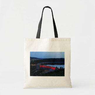 Edersee lit up concrete dam in the evening tote bag