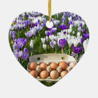 Egg box with chicken eggs in crocuses ceramic heart ornament