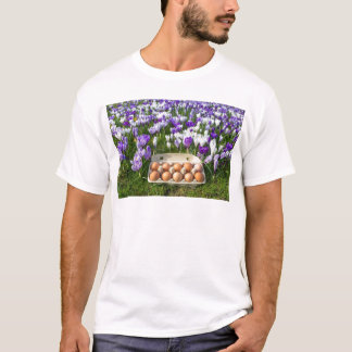 Egg box with chicken eggs in crocuses T-Shirt