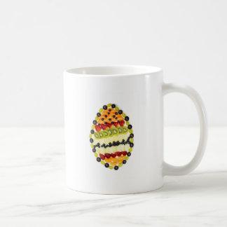 Egg shaped fruit pie with various fruits coffee mug