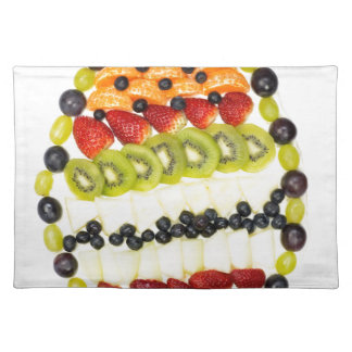 Egg shaped fruit pie with various fruits placemat