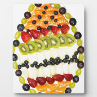 Egg shaped fruit pie with various fruits plaque