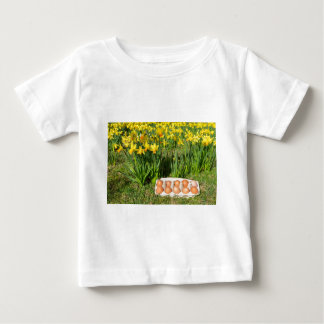 Eggs in box on grass with yellow daffodils baby T-Shirt