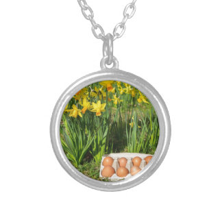 Eggs in box on grass with yellow daffodils silver plated necklace