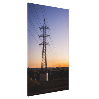 Electricity tower close to an urban area against a canvas print