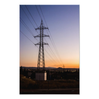 Electricity tower close to an urban area against a photo print