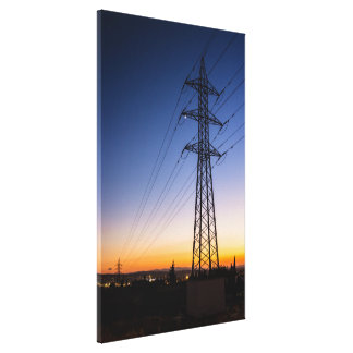 Electricity tower close to an urban area canvas print