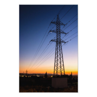 Electricity tower close to an urban area photo print