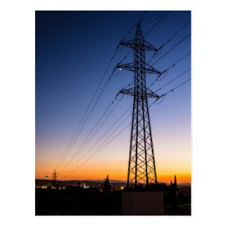 Electricity tower close to an urban area postcard