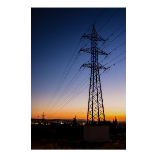 Electricity tower close to an urban area poster