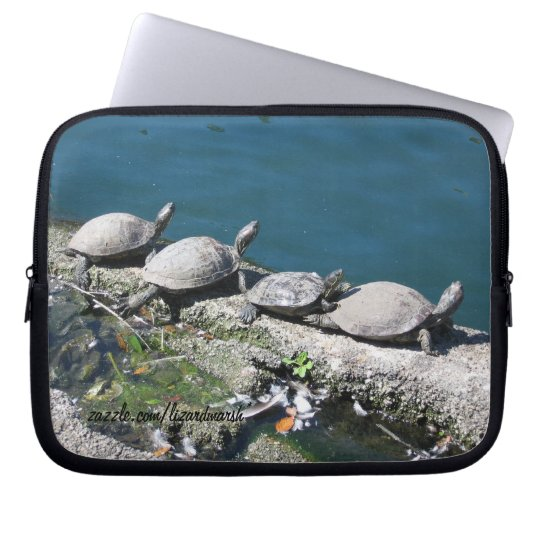 Electronics bag featuring family of turtles