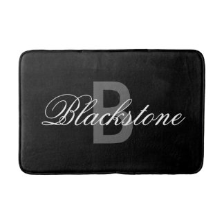 Elegant black monogram bath mat for bathroom