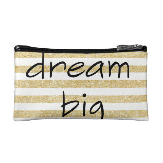 elegant dream big text on a gold and white cosmetic bag