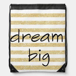 elegant dream big text on a gold and white drawstring bag