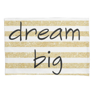 elegant dream big text on a gold and white pillowcase