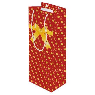 Elegant golden polka dots and ribbon wine gift bag