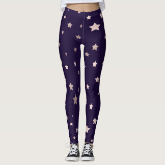 elegant rose gold stars on a purple background leggings