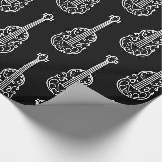 Elegant violins on black wrapping paper