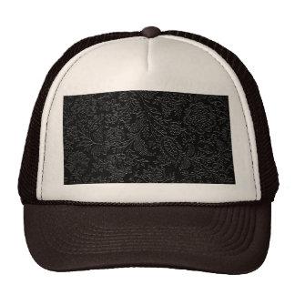 Elegant white floral pattern on a black background trucker hat