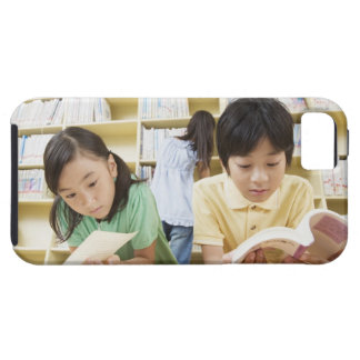 Elementary school students reading a book case for the iPhone 5
