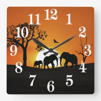 Elephants at sunset square wall clock