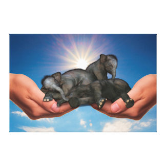 Elephants in Hand Canvas Print
