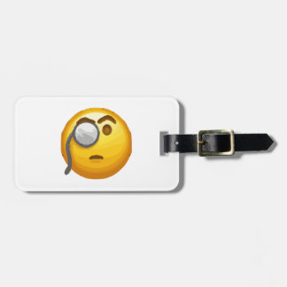 emoji monocle luggage tag