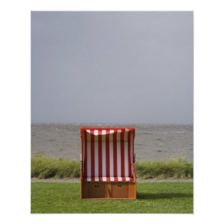 empty beach chair in front of sea poster