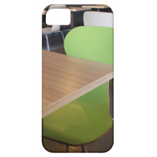 Empty tables and chairs in cafes without visitors iPhone 5 case
