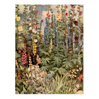 Enfant dans un jardin carte postale