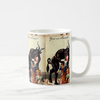 Enfants de Krampus dans la tasse de Noël de