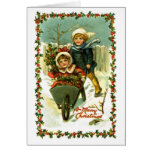 Enfants vintages de carte de Noël dans la neige