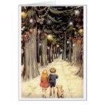 Enfants vintages de carte de Noël sur la route ave