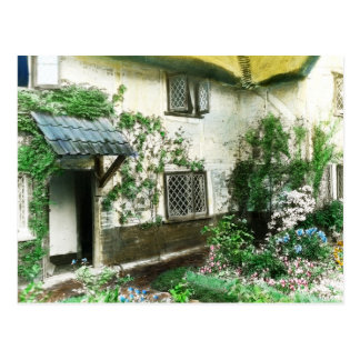 English cottage garden with ivy framing the door postcard