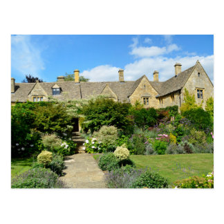 English house with flower garden postcard